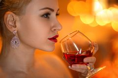 Beautiful woman with the glass of wine stock photos