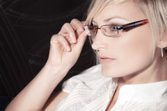 Beautiful woman with glasses close up Royalty Free Stock Images