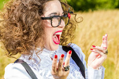 Beautiful woman in glasses having fun outdoors Stock Photo
