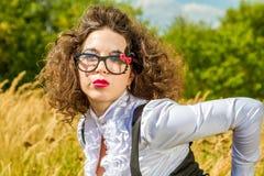 Beautiful woman in glasses having fun outdoors Stock Image