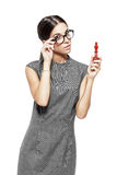 Beautiful woman in glasses holding king Stock Photo