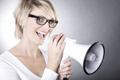 Beautiful woman with glasses and  megaphone Royalty Free Stock Photo