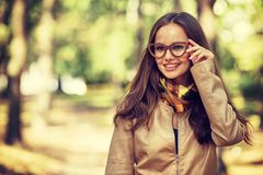 Beautiful woman in glasses outdoors in sunny day. Royalty Free Stock Image