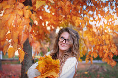 Beautiful woman with glasses in the park in autumn Royalty Free Stock Photography