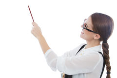 Beautiful woman with glasses pointing at copy space Royalty Free Stock Photos