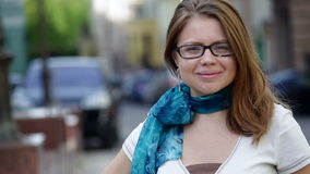 Beautiful woman in glasses posing in the city stock video footage