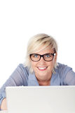 Beautiful Woman With Glasses Using Laptop Stock Photography