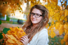 Beautiful woman with glasses walks in autumn park Stock Photography