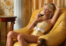Beautiful woman with glasss wine in luxury inter Royalty Free Stock Photography