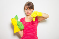 beautiful woman with gloves and cloth  on white. Royalty Free Stock Images