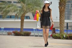 Beautiful woman goes in shopping Royalty Free Stock Photos