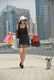 Beautiful woman goes in shopping Stock Photo