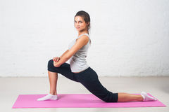 Beautiful woman goes in for sports, fitness, doing exercises with a smile, stretching. Healthy lifestyle, health. Beautiful woman goes in for sports, fitness Stock Photography