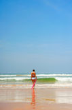 Beautiful woman going into the ocean Royalty Free Stock Photos