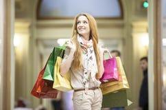 Beautiful woman going shopping Stock Images