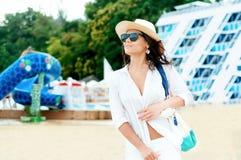 Beautiful woman going sunbathing at ocean resort Stock Images