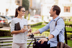 Beautiful woman going to work with colleague Royalty Free Stock Photo