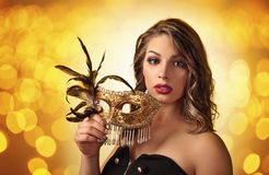 Beautiful woman with gold carnival mask Royalty Free Stock Images