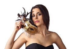 Beautiful woman with gold carnival mask isolated on white backgr Stock Photo