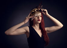 Beautiful woman with gold carnival mask Royalty Free Stock Image