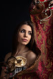 Beautiful woman with gold carnival masks Royalty Free Stock Photography