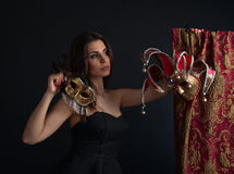 Beautiful woman with gold carnival masks Royalty Free Stock Photos