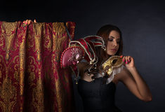 Beautiful woman with gold carnival masks Royalty Free Stock Image