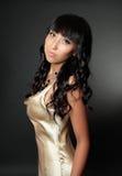 Beautiful woman in gold dress Stock Photos