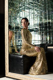 Beautiful woman in gold dress Royalty Free Stock Image