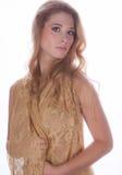 Beautiful Woman in Gold Fabric Stock Image