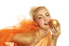 Beautiful woman in gold with gold apple Royalty Free Stock Image