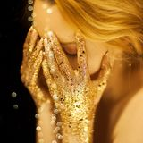 Beautiful woman in gold, golden hands, glitter sensual glamour luxury stock images