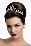 Beautiful woman with gold makeup.Beautiful bride with fashion wedding hairstyle. Royalty Free Stock Photos