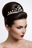 Beautiful woman with gold makeup.Beautiful bride with fashion wedding hairstyle. Stock Photo