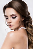 Beautiful woman with gold makeup.Beautiful bride with fashion wedding hairstyle. Royalty Free Stock Photo