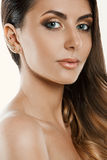 Beautiful woman with gold makeup.Beautiful bride with fashion wedding hairstyle. Royalty Free Stock Images