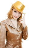 Beautiful woman in a gold suit Royalty Free Stock Photography