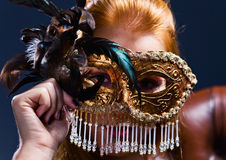 Beautiful woman with gold venetian mask Stock Image