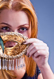 Beautiful woman with gold venetian mask Stock Images