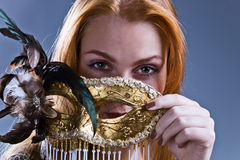 Beautiful woman with gold venetian mask Royalty Free Stock Photos