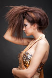 Beautiful woman in golden dress royalty free stock photography