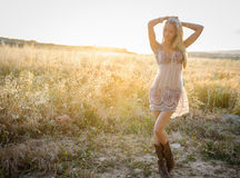 A beautiful woman in golden hay field 3 Stock Photo