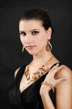 Beautiful woman in golden jewelry Stock Image