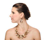 Beautiful woman in golden jewelry Royalty Free Stock Photo
