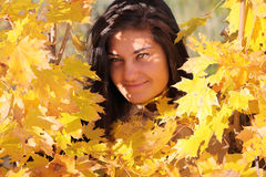 Beautiful woman with golden maple Royalty Free Stock Photo