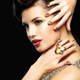 Beautiful woman with golden nails and style makeup Royalty Free Stock Photo