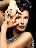Beautiful woman with golden nails and style makeup Stock Photo
