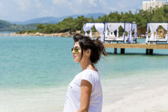 Beautiful woman with golden  sunglasses  on a sea background Stock Photography