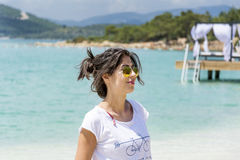 Beautiful woman with golden  sunglasses  on a sea background Stock Image