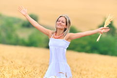 Beautiful woman in golden wheat field Royalty Free Stock Image